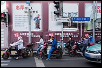 Motercycle riders waiting at trafic light. Shanghai, China ( color)