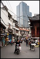 Old street and modern tower. Shanghai, China ( color)