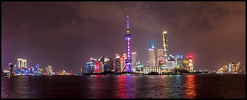 Shanghai city skyline from the Bund at night. Shanghai, China (Panoramic color)
