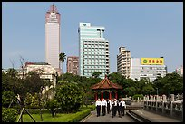 Office workers, 2-28 Peace Park, and high rises. Taipei, Taiwan ( color)