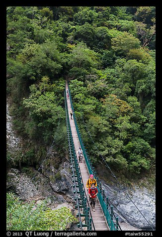 Hikers cross suspension bridge. Taroko National Park, Taiwan