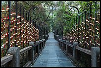 Stairs to temple lined up with blessing wind chimes. Sun Moon Lake, Taiwan ( color)