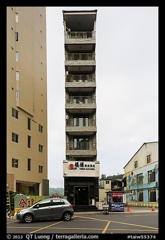 Tall and thin hotel building. Sun Moon Lake, Taiwan (color)