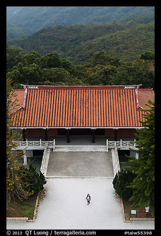 Woman and temple from above, Tsen Pagoda. Sun Moon Lake, Taiwan
