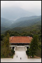 Two people, temple, and misty mountains, Tsen Pagoda. Sun Moon Lake, Taiwan (color)