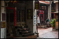 Man on bicycle amidst old houses in alley. Lukang, Taiwan ( color)