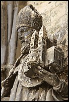 Statue outside of Notre Dame Cathedral showing a model of the cathedral being held. Tournai, Belgium ( color)
