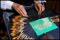 Lacemaker's hand at work. Bruges, Belgium (color)