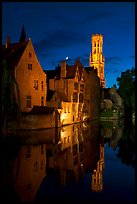 Old houses and belfry Quai des Rosaires, night. Bruges, Belgium ( color)