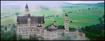 Neuschwanstein castle and fog. Bavaria, Germany (Panoramic color)