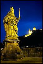 Saint Killian statue on  Alte Mainbrucke (bridge) and Festung Marienberg (citadel) at night. Wurzburg, Bavaria, Germany ( color)