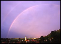 Rainbow over Nesselwang and St Andreas church. Bavaria, Germany ( color)