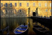Boat and moat of Vadstena slott. Gotaland, Sweden (color)