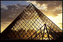 Sunset and clouds seen through Pyramid, the Louvre. Paris, France ( color)