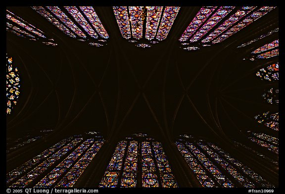 Ceiling and stained glass of Upper Holy Chapel. Paris, France