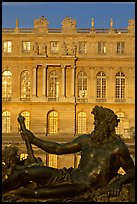 Statue, basin, and Versailles palace facade, late afternoon. France ( color)