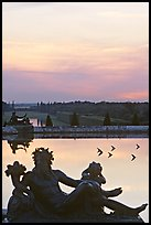 Sculptures, basin, and gardens at dusk, Versailles Palace. France
