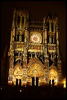 Cathedral facade laser-illuminated at night to recreate original colors, Amiens. France