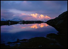 Mont Blanc range reflected in pond at sunset, Chamonix. France ( color)