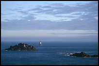 Islets and lighthouse on the coast. Brittany, France ( color)