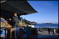 Oyster stand and vendor in Cancale. Cancale oysters are reknown in France. Brittany, France