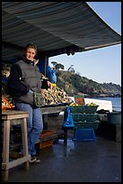 Oyster stand and vendor in Cancale. Brittany, France