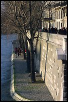 Walking on the banks of the Seine on the Saint-Louis island. Paris, France ( color)