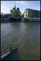 Fishing in the Seine river, Notre Dame Cathedral in the background. Paris, France ( color)