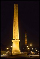 Luxor obelisk of the Concorde plaza and Eiffel Tower at night. Paris, France ( color)