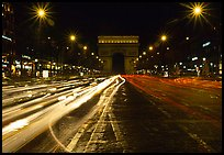 Arc de Triomphe seen from the middle of Champs Elysees at night. Paris, France ( color)