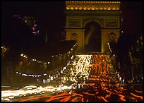 Arc de Triomphe and Champs Elysees at night with car light trails. Paris, France ( color)