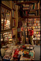 Picking-up a book in Shakespeare and Co bookstore. Quartier Latin, Paris, France ( color)