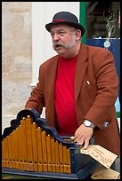 Street musician with Barrel organ. Quartier Latin, Paris, France (color)