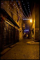 Lonely street by night with Tabac sign and Christmas lights. Carcassonne, France ( color)