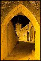 Ramparts and tower framed by gate at night. Carcassonne, France ( color)