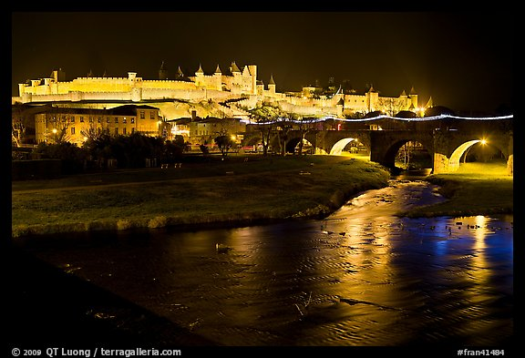 Fortified city and Pont Vieux crossing the Aude River by night. Carcassonne, France