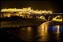 Fortified city and Pont Vieux crossing the Aude River by night. Carcassonne, France ( color)
