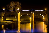 Pont Vieux illuminated by night with Christmas lights. Carcassonne, France