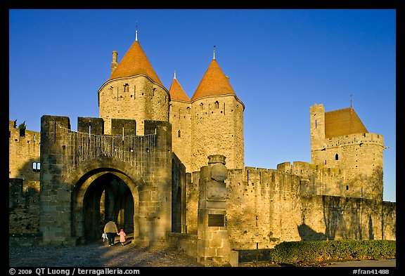 Main entrance of medieval city  with child and adult walking in. Carcassonne, France
