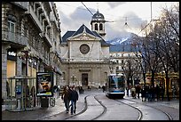 Street with people walking, tramway and church. Grenoble, France ( color)