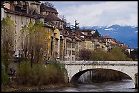 Stone bridge, houses, and snowy mountains. Grenoble, France ( color)
