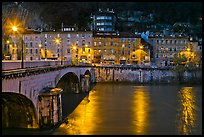 Isere River, Citadelle stone bridge and old houses at dusk. Grenoble, France ( color)