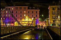 Pedestrians on suspension bridge at night. Grenoble, France ( color)
