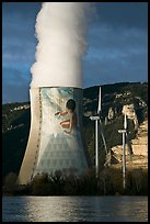 Cooling tower of nuclear power plant with ecology-themed art by Jean-Marie Pierret, and windmill. Provence, France ( color)