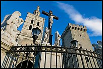 Crucifix in front of Notre-Dame-des-Doms Cathedral. Avignon, Provence, France (color)