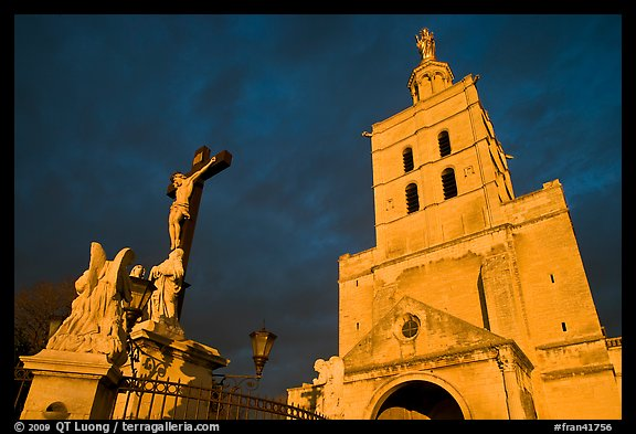 Crucifix and romanesque tower of Notre-Dame-des-Doms Cathedral. Avignon, Provence, France