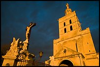 Crucifix and romanesque tower of Notre-Dame-des-Doms Cathedral. Avignon, Provence, France ( color)