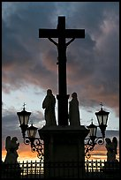 Cross and statues with sunset clouds. Avignon, Provence, France ( color)