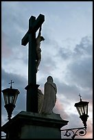Cross with Christ at sunset. Avignon, Provence, France