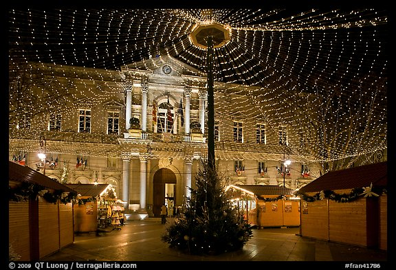 Christmas fair and City hall at night. Avignon, Provence, France (color)